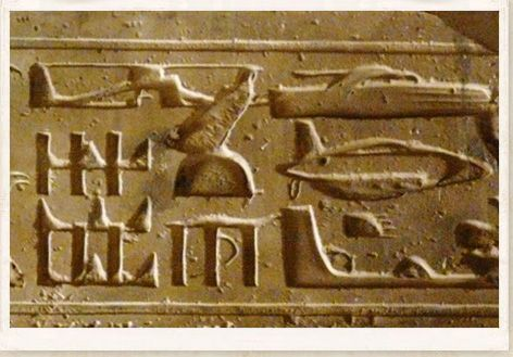 Egyptian temple wall at Abydos are strange hieroglyphics which depict what appears to be modern day aircraft.